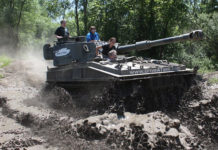Photo courtesy of Drive A Tank - FV433 Abbot driving through the mud